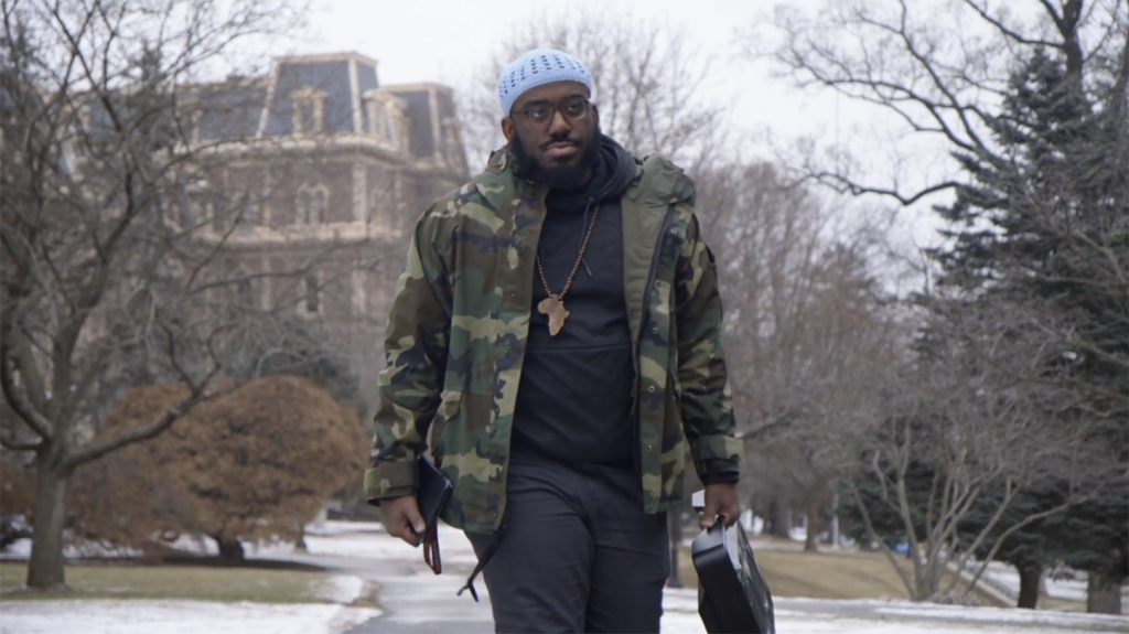 Charles Evans '19 holds his boombox while walking on campus.